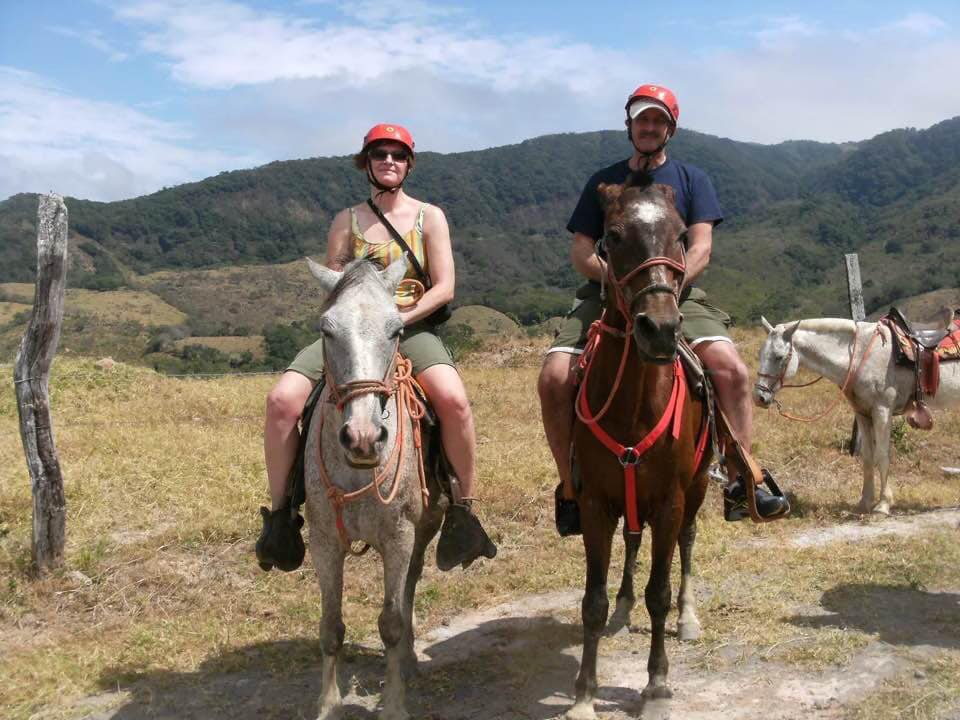 Vito riding in Cuba with wife, Anne
